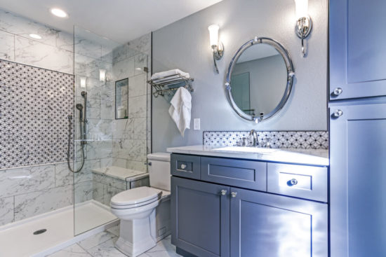 Luxury bathroom design with Marble shower Surround and mosaic accent tiles.