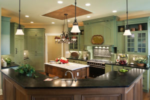 Country style gourmet kitchen in a residential home with painted custom cabinets, marble topped center island, soapstone counter tops and tin ceiling inlay.