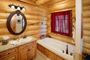 The bath room in a rustic log cabin, in the mountains.