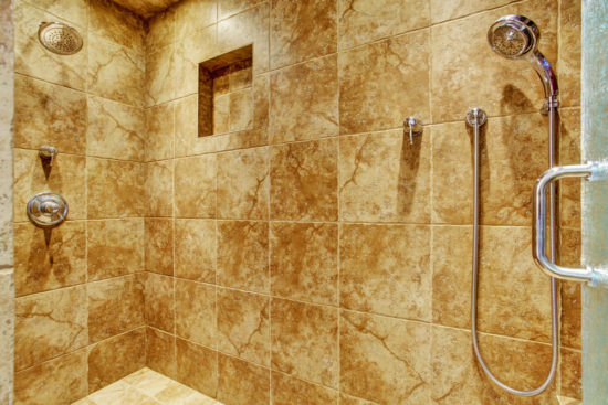 Granite tile wall trim in luxury bathroom