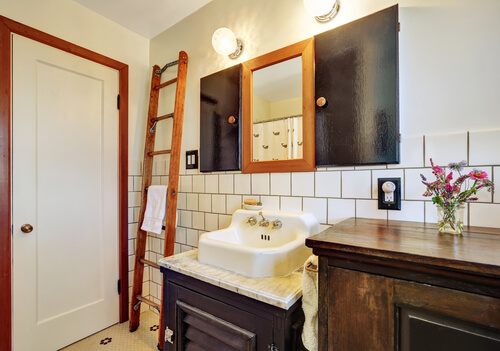 Old style bathroom interior with vintage washbasin and tile wall trim. Northwest, USA