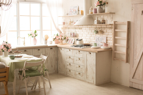 kitchen with bright fresh flowers. kitchen interior in green