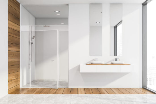 Interior of modern bathroom with white and wooden walls, tiled floor, double sink with two mirrors above it and shower stall with glass door. 3d rendering