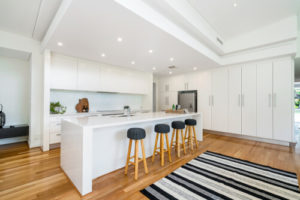 Large kitchen with stone bench tops and timber flooring in modern home. NEDLANDS, PERTH, WESTERN AUSTRALIA. MAY 2019.
