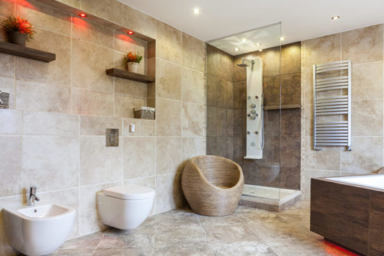 This is an image of an Interior of luxury bathroom with beige tiles
