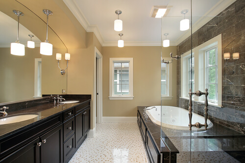 Master bath in new construction home with black tub area