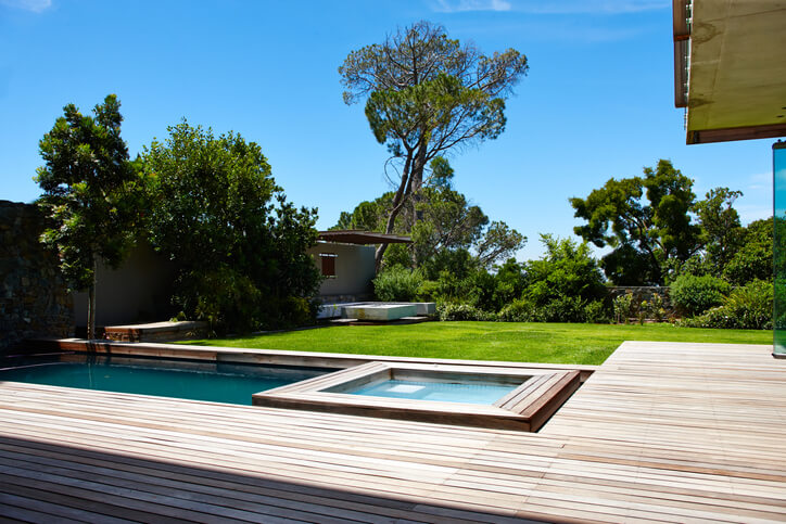 A contemporary back garden with swimming pool