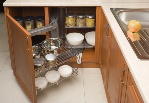 detail of open kitchen cabinet with cans of beans