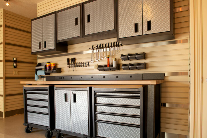 """Garage workspace with cabinets, countertop and tools"""
