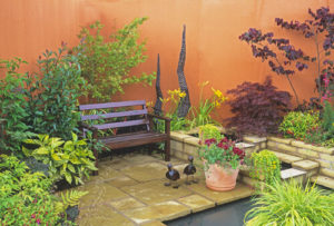 Seating next to water feature in small courtyard garden
