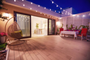 evening patio area with open space kitchen and sliding doors