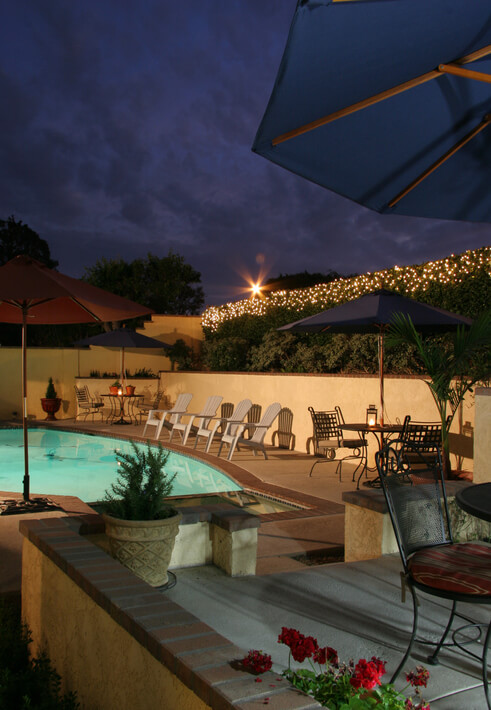 """Back yard patio and pool at night. Shot at 100 ISO, f11, 25 seconds."""