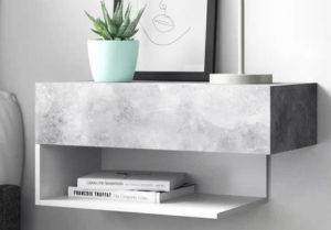 This modern and streamlined wall-mounted bedside table is at home in contemporary bedroom interiors. It includes one drawer that sits on smooth-running glides, an upper surface that has plenty of space for a lamp, alarm clock and a glass of water, plus an additional lower shelf for other bedside essentials. Assembly is required.