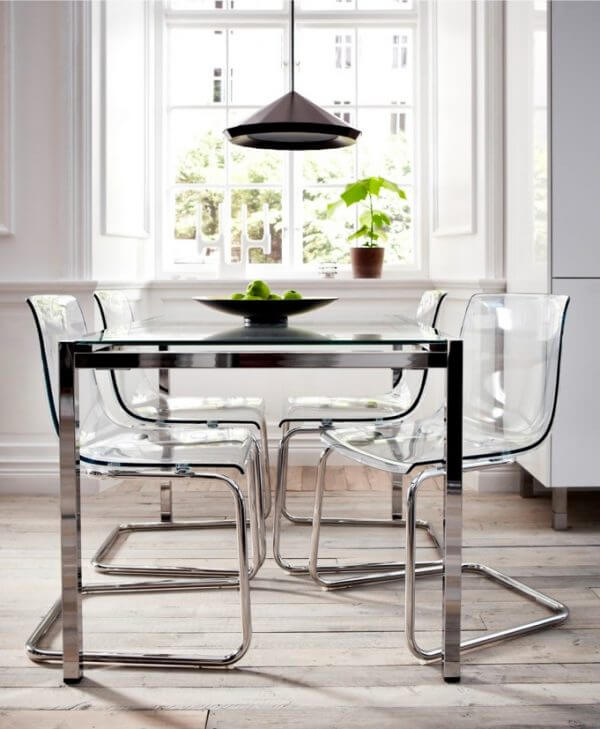 Ikea Tobias Chair: Transparent acrylic dining chairs are great for small spaces because they take up very little visual real estate, and they're great for window spots because they allow the light to pass right through. Ikea's Tobias chair features chrome legs and glass-like seats for a smart contemporary look.